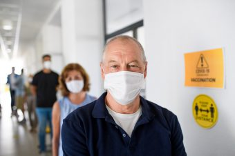 Portrait,Of,People,With,Face,Masks,Waiting,,Coronavirus,,Covid-19,And