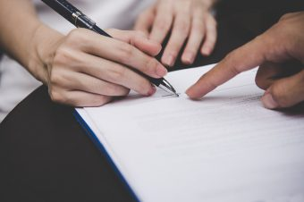 Women,People,Hand,Signing,A,Contract,On,Document,For,Building