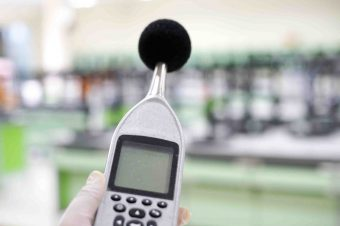 Measuring the noise in laboratory room with a sound level meter.