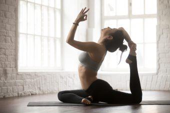 Young,Yogi,Woman,Practicing,Yoga,Concept,,Doing,One,Legged,King